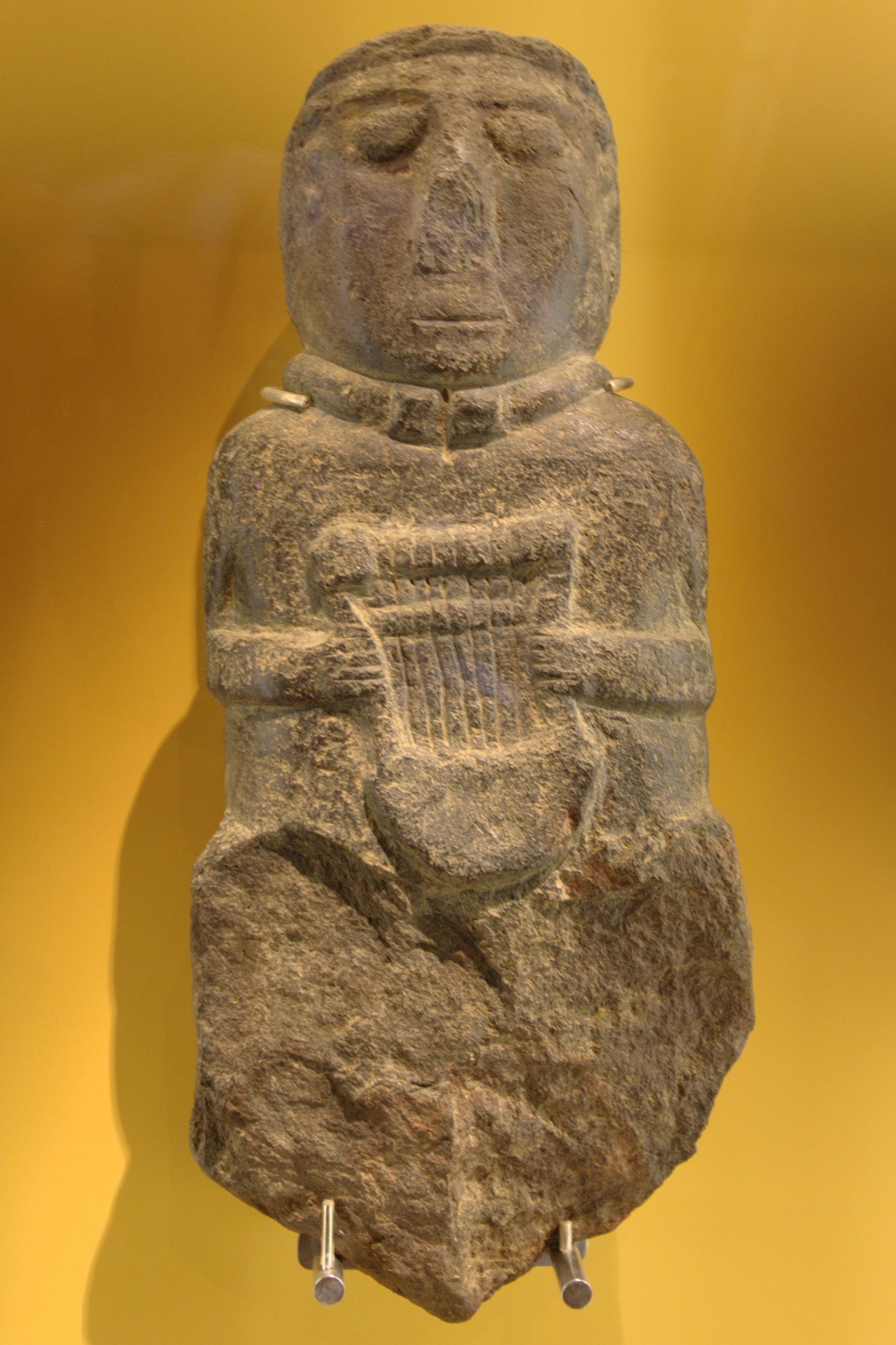 ancient Gallo-Celtic statue with an ancient Celtic crwth (lyre)